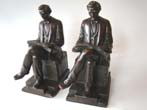 click to view detailed description of A large and fine pair of Abraham Lincoln bookends made by the Pompeian Bronze Company circa 1925
